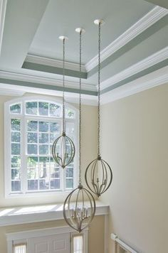 how to hang lighting in double-height foyer and stairwell  (diagonal)