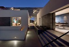 This modern desert home by assemblageSTUDIO with indoor/outdoor living is a layered design with gorgeous sculpture and artwork on each level.