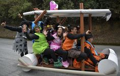 Participants descend a hill in a home-made car depicting the Flintstones during the XXVI Car Festival in Medellin, Antioquia department, Colombia, on September 6, 2015. (Raul Arboleda, AFP/Getty Images)
