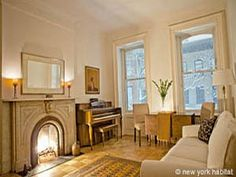 This 1 bedroom rental is just a few doors away from Carrie Bradshaw's place in the West Village of Manhattan! Its high ceilings, hardwood floors, functional piano and marble fireplace definitely make it a chic apartment to live in New York! - OMG you mean I could be Carrie's neighbor??? (You know if she was real) Love!