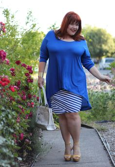 I own the blue and white pencil skirt she's wearing. :) I pair it with a black 3/4 sleeve shirt and black booties - Torrid