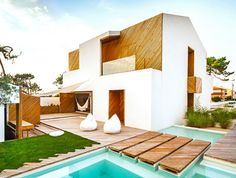 House transformed into work of art by using untreated wood and earthy, neutral colors.