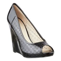 """Peep toe pump with all leather upper featuring cut out detailing.  4 1/4"""" wedge and 1/4"""" platform.  This style is available exclusively @ Nine West Stores & ninewest.com."""