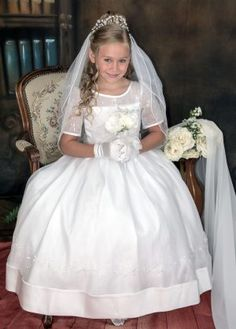 This beautiful long length, short sleeve first communion dress is an exclusive . This communion gown features organza over satin with intricate embroidery and pearls. Shop Embroidered First Communion Dresses for Sale Designer First Communion Dresses, Girls First Communion Dresses, First Communion Veils, Holy Communion Dresses, Communion Cakes, Plum Flower Girl Dresses, Little Girl Dresses, Girls Dresses, Flower Girls