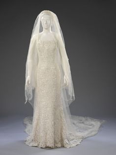 Wedding dress, Deborah Milner, 1997. Deborah Milner designed this dress for the finale of a series of popular television advertisements for Renault's Clio car. This wedding dress, veil and shoes were worn by the actress Estelle Skornik as 'Nicole' in the Renault television advertisement. An estimated 23 million viewers saw the ad.