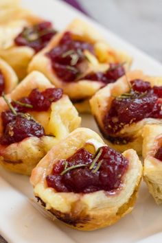 Pop one of these Cranberry Brie Bites into your mouth for an instant Party of flavors. Quick & easy made with Puff Pastry. Pop one of these Cranberry Brie Bites into your mouth for an instant Party of flavors. Quick & easy made with Puff Pastry. Puff Pastry Recipes Savory, Brie Puff Pastry, Puff Pastry Appetizers, Brie Appetizer, Easy Appetizer Recipes, Yummy Appetizers, Appetizer Party, Puff Pastries, Appetizer Ideas