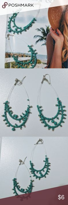 Turquoise Carribean feel Dangle earrings These are a blue-green or rather turquoise-ey beaded earnings with a clear wire up to the silver colored hoop that goes through the lobe. They always reminded me of a beachey carribean feel. Jewelry Earrings