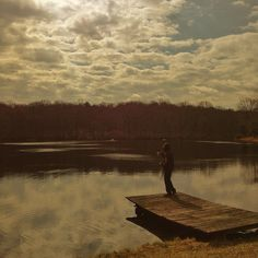 This is a painting but I love the lake late in the day when the water is still.