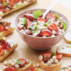 Strawberry Caprese Salad. Fresh basil, strawberries, and mini balls of mozzarella.