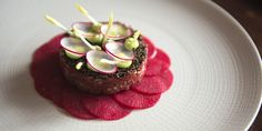 Juicy beef fillet is paired with fiery wasabi in this vibrant beef tartare recipe by Adam Bennett.