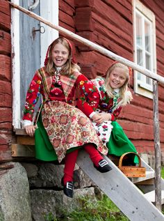 two girls in brightly colored folk costumes from Dala-Floda, Sweden