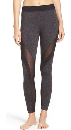 frame mixed media leggings by KORAL ACTIVEWEAR. Ventilating mesh and flattering dark panels give fun, supportive definition to these athletic mid-rise leggings.