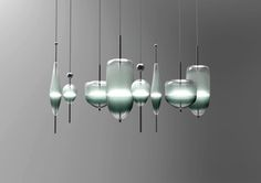 Contemporary chandelier composed of blown glass lights bearing shapes reminiscent of nautical buoys, designed by Nao Tamura.