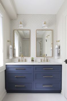 Deep blue painted cabinets in an otherwise all white bathroom. I also love the h… Deep blue painted cabinets in an otherwise all white bathroom. I also love the hexigon tile wall, an All White Bathroom, Modern Bathroom, Navy Bathroom, Double Sink Bathroom, Boho Bathroom, Bathroom Colors, Little Boy Bathroom, Bungalow Bathroom, Cottage Style Bathrooms