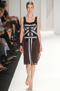 Carolina Herrera 2012.  This beaded black dress with art deco design and simple straps is an homage to the 1920s flapper era.