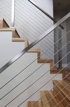 Project # 262 - Cable Railing Contest Winner - StairStupplies™ This project won the 2017 Summer Completed Project Contest. The customer took photos displaying her stainless steel cable railing system's beauty. Stairway Railing Ideas, Staircase Railing Design, Interior Stair Railing, Balcony Railing Design, Cable Stair Railing, Modern Stair Railing, Modern Stairs, Glass Stair Railing, Steel Railing Design