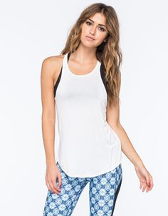 """Full Tilt Sport hi neck tank. This basic racerback tank has a hi neck silhouette with low armscyes and a slightly curved hemline. Pair with cool mesh lined capri leggings for a cute workout look. 96% rayon/4% spandex. Hand wash. Imported.<BR><BR>Model is wearing a size small. Model measurements:<BR>Height: 5'8""""<BR>Chest: 34""""<BR>Waist: 23""""<BR>Hips: 34"""""""