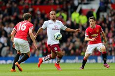 Gabriel Agbonlahor of Aston Villa battles for the ball with Michael Carrick of Manchester United and Ander Herrera of Manchester United during the Barclays Premier League match between Manchester United and Aston Villa at Old Trafford on April 4, 2015 in Manchester, England.