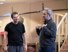 """Director Sam Mendes (right) gives Douglas Hodge some tips during rehearsals of the Theatre Royal Drury Lane's production of the new musical """"Charlie and the Chocolate Factory"""", 2013.  This show opened in the West End and ran for three years.  It was then moved to Broadway where it lasted nine months. Charlie Chocolate Factory, Sam Mendes, Nine Months, Roald Dahl, Musical Theatre, Behind The Scenes, Musicals, Broadway, Film"""