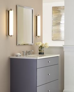 Feiss Edgebrook LED bath lights flank a mirror, creating an ideal wash of light for every morning and night