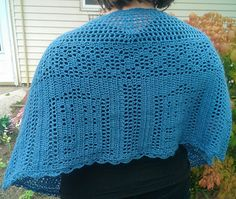 in my search for a crochet TARDIS shawl, i discovered that i couldn't find any. so i was inspired by Amy Schilling's Doctor Who Fair Isle charts to make my own downsized TARDIS and fiddle with ideas for decorative mesh rows as well.