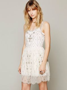 BEAUTIFUL! It shows it in White but says it comes in rose. Free People Starry Night Slip, $78.00