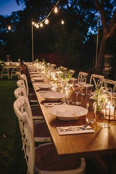 Wedding under the stars. Margaret River. Arimia. Festoon lights. Edison bulbs. Outdoor dance floor. Under the trees. Wooden dance floor. Rustic. Vintage. Wooden tables. Romantic lighting. Outdoor wedding. Long reception tables. Photo by Merge photography.