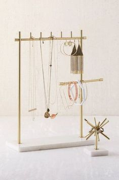 Using pretty jewelry holders is an easy way to decorate your dorm room on a budget!