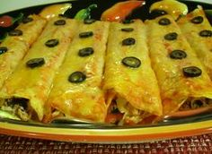 FIESTA ENCHILADAS  Loaded with chicken and cheese, these spicy enchiladas turn your meal into a party.
