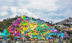 The government of Mexico collaborates with local street artists, Germen Crew, to complete this amazing urban renewal project. 209 homes were painted in Pachuca, Mexico to complete the square meter mural.