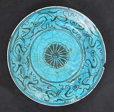 Dish, 16th–17th century  Iran Stonepaste; painted in black under turquoise glaze