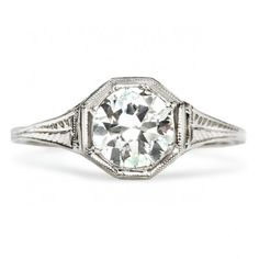 Midville is a vintage Edwardian engagement ring featuring a 0.89ct Round Brilliant cut diamond in a unique octagonal setting. Lovely! TrumpetandHorn.com   $6,175