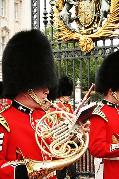Playing the French Horn: A welsh guardsman. French horn and sweet dudes in black furry hats I love it!!!!
