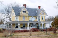 McGhee House - A butter-yellow mansion, with a huge front porch. Love