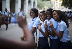 Pre-university students pose for a photo during the first day of class for the 2015-2016 course in downtown Havana on September 1, 2015. Universal free education is one of the pillars of the socialist society built in Cuba since Fidel Castro's 1959 revolution.