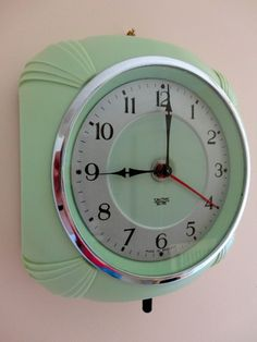 Oh my! This reminds of an old Eisley's ice cream shop we used to stop in! Love the color! Bakelite Clock.