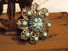 Vintage silvertone and faux turquoise pin by sistersfuntreasures, $5.00