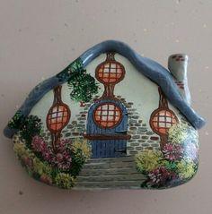 A quaint cottage painted rock!.