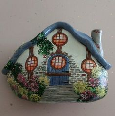 A quaint cottage painted rock!.