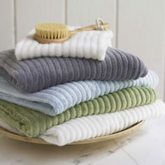 Super soft towels in white and light blue.