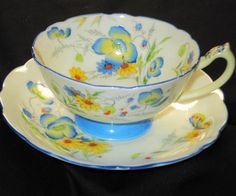 STAR PARAGON ART DECO BLUE YELLOW BUTTERFLY TEA CUP AND SAUCER