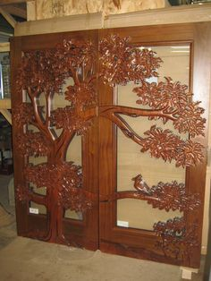These are two hand carved Mahogany doors with carving on both sides. I
