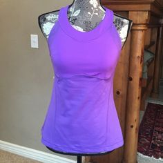 Lavender lulu lemon tank top Lulu lemon lavender workout top size M. Super cute and practically brand new. Only worn 1-2 times. lululemon athletica Tops Tank Tops