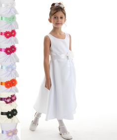 Brianna: Satin Communion Dress with Removable SashBrianna: White Satin Communion Dress This is a popular style choice for a first holy communion dress. The sweet scoop neck and sleevless design features a sweeping side layer and a double faced satin sash. For a communion this sash can be white with white flowers. 20 sash colors can be selected.