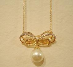 Delicado colar com banho de ouro e pérola de água doce