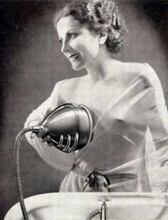 "Vintage apparatus for promoting or maintaining perfect upright breasts using water pressure and cold water. French ad where the copy promises: ""The doctor says YES you can firm up your bosom""  See http://www.pygmalionsfantasy.com/2012/09/beautiful-bosom.html"
