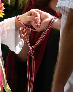 """Handfasting: The term """"tying the knot"""" originates with the practice of handfasting. During the ceremony, the couple's hands are tied together with one or several colored cords or ribbons, symbolizing the desire of the couple to be united. The cord is often kept by the couple in a box or ornate bag as a reminder of their vows."""