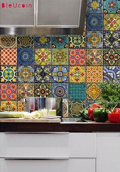 Ugly rental kitchen temporary solution! Talavera Tile Decals. So freakin' awesome.