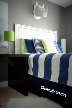 Blue, green, and monochrome boy's room designed to last until teens.