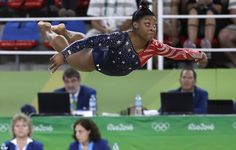 Flying huigherforms on the floor during the artistic gymnastics women's qualification at the 2016 Summer Olympics in Rio de Janeiro, Brazil, Sunday, Aug. 7, 2016. (AP Photo/Rebecca Blackwell)